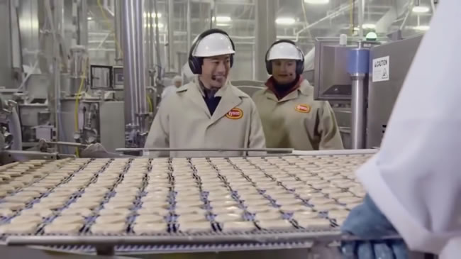 Shaped nuggets traveling on the conveyor